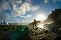 Surfers and Waipio valley at first light The Big Island of Hawaii, Pacific Ocean