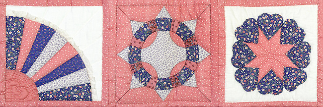 This three block panorama from a small hand-stitched quilt uses three traditional geometric designs with the leftmost block having a rising sun which is also one of the few asymmetrical areas in the overall piece. This section is based on eights: eight sun rays, and each star has eight points and eight accompanying fill pieces.<br />