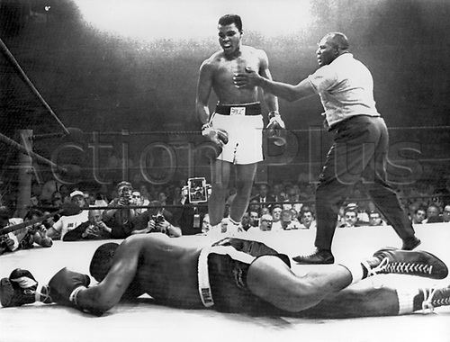 "25.05.1965. Lewiston, Maine, USA. Scene of one of the shortest heavyweight championship box fights between defending champion Muhammad Ali (former Cassius Clay) and challenger Charles ""Sonny"" Liston (on the canvas). To the right referee Walcott. Cassius Clay knocked Sonny Linston out within the first minute of the first round. Muhammad Ali died on June 3rd 2016 of a respiratory complication in a Phoenix hospital."