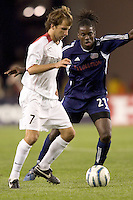 Mike Magee (MetroStars) brings the ball back on offense as Shalrie Joseph (Revolution) defends. The NE Revolution defeated NY Metro Stars, 1-0, on September 24 at Gillette Stadium.