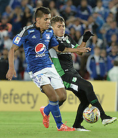 BOGOTA - COLOMBIA -19 -08-2015: Sergio Villareal (Izq) jugador de Millonarios disputa el balón con Andres Felipe Roa (Der) jugador de Deportivo Cali durante partido por la fecha 7 de la Liga Águila II 2015 jugado en el estadio Nemesio Camacho El Campín de la ciudad de Bogotá./ Sergio Villareal (L) player of Millonarios fights for the ball with Andres Felipe Roa (R) player of Deportivo Cali during the match for the 7th date of the Aguila League II 2015 played at Nemesio Camacho El Campin stadium in Bogotá city. Photo: VizzorImage / Gabriel Aponte / Staff.