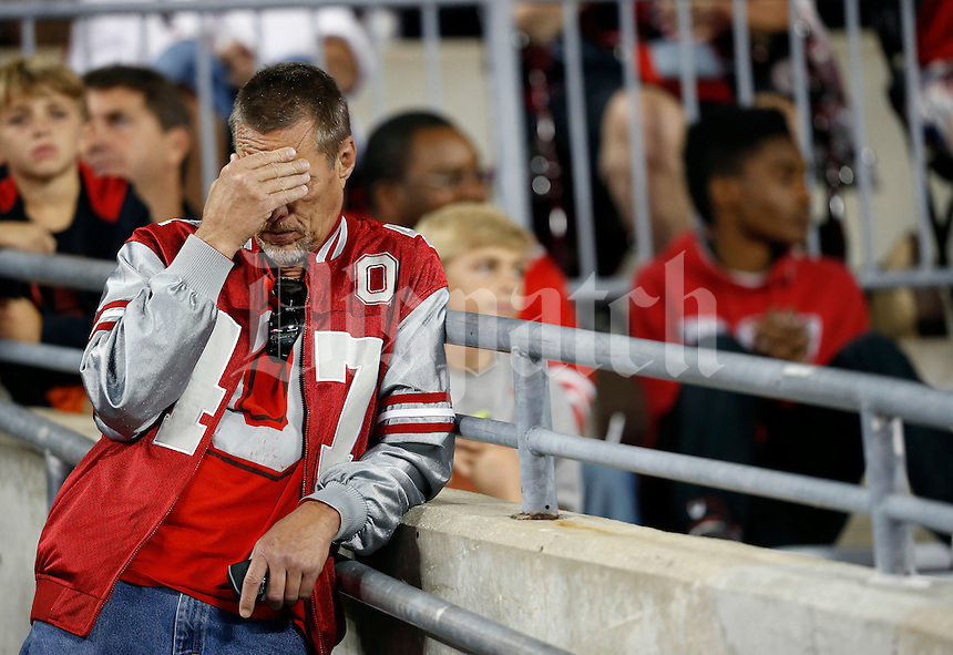 An Ohio State fan shows frustration following a Cincinnati touchdown during the third quarter of the NCAA football game at Ohio Stadium in Columbus on Sept. 27, 2014. (Adam Cairns / The Columbus Dispatch)