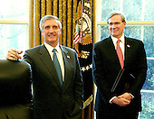 Washington, D.C. - January 13, 2006 -- White House Chief of Staff Andy Card, left, and National Security Advisor Steve Hadley, right, look on as  United States President George W. Bush makes remarks to the press after meeting with three business leaders to discuss raising money privately for those affected by the storms and natural disaster in Guatemala and Honduras. <br /> Credit: Ron Sachs / Pool
