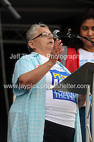 Peoples March for the NHS - Central London, Saturday 6th Sept 2014 - <br /> <br /> An NHS nurse speaks in support of the NHS rally<br /> <br /> <br /> <br /> <br /> Photographer: Jeff Thomas - Jeff Thomas Photography - 07837 386244/07837 216676 - www.jaypics.photoshelter.com - swansea1001@hotmail.co.uk