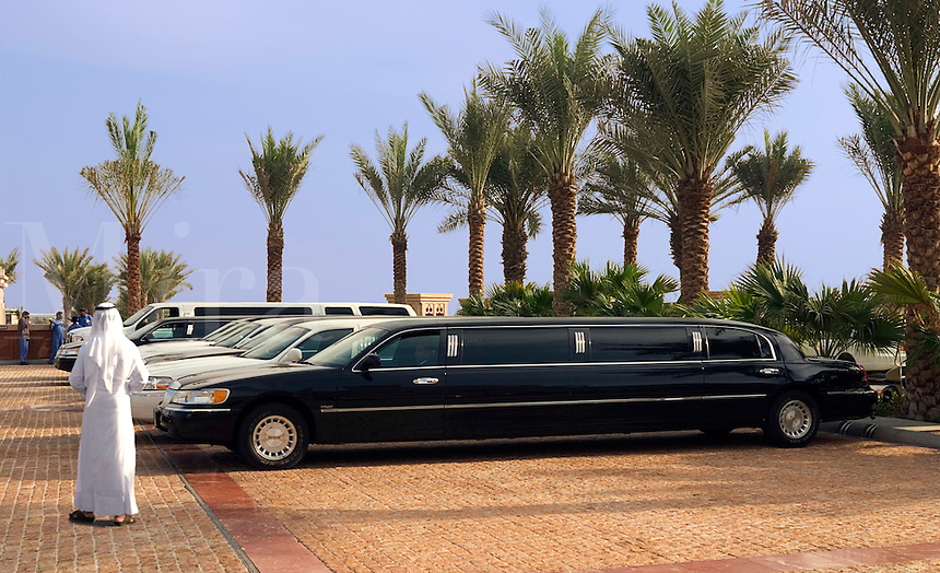 Dubai, United Arab Emirates. Al Qasr Hotel. Stretch limousines waiting outside the hotel. Arab man in kandora.&amp;#xD;<br />