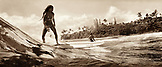 USA, Hawaii, Hilo, girls surf on a wave at Honoli'i beach, The Big Island (B&W)