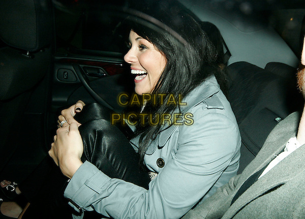 MARTINE McCUTCHEON.At Kabaret Club, London, UK..March 15th, 2006.Ref: SW.half length car profile laughing.www.capitalpictures.com.sales@capitalpictures.com.©Capital Pictures.