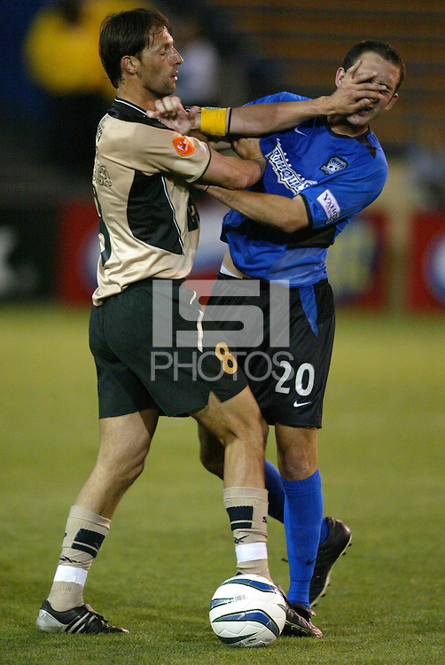12 May 2004:  Portugal Pedro Barbosa throws a slap at Earthquakes Ryan Cochrane at Spartan Stadium in San Jose, California.  Earthquakes defeated Sporting Club of Portugal, 4-1..Mandatory Credit: Michael Pimentel/ISI