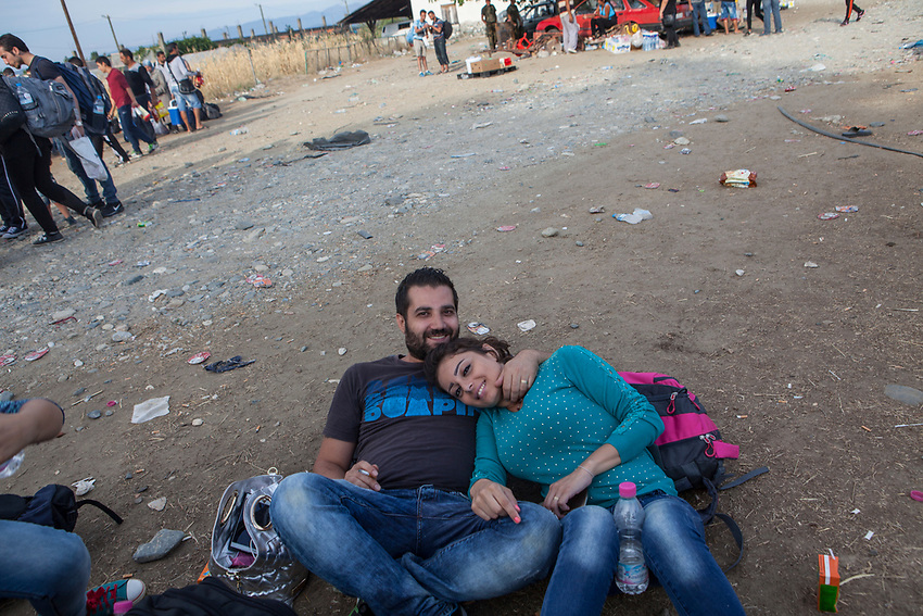 Married couple Elias Bairam and Mirna Nakoula Bairam rest while waiting to be registered at UNHCR Registration Centre in Gevgeliya, Macedonia. Refugees at Gevgelija Border Crossing Macedonian Side