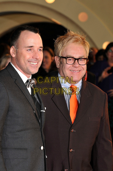"DAVID FURNISH & SIR ELTON JOHN.""Australia"" UK film premiere, Odeon cinema, Leicester Square, London.10th December 2008.half length black suit jacket glasses couple married orange tie .CAP/PL.©Phil Loftus/Capital Pictures"