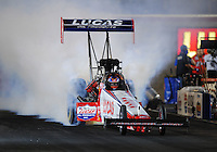 Oct. 31, 2008; Las Vegas, NV, USA: NHRA top fuel dragster driver Morgan Lucas does a burnout during qualifying for the Las Vegas Nationals at The Strip in Las Vegas. Mandatory Credit: Mark J. Rebilas-