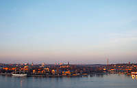 A wide panoramic evening view over Strommen Stockholm Strom with from left to right the af Chapman tree mast ship and youth hostel at Skeppsholmen, Kastellholmen The Kaknastornet Kaknas Tower in the background Stockholm, Sweden, Sverige, Europe