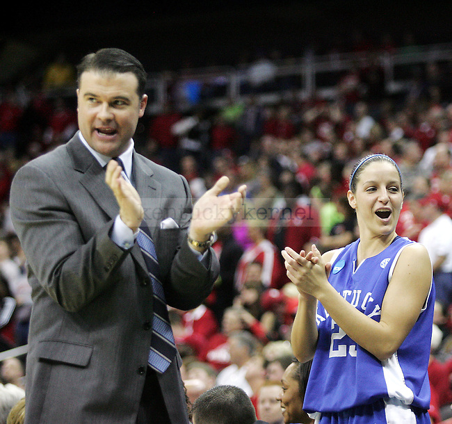 UK head coach Matthew Mitchell and sophomore Rebecca Gray clap as the No. 4 UK looks to beat No. 1 Nebraska on Sunday, March 28, 2010 at the Women's Sweet 16 Tournament in Kansas City, Mo. The Cats defeated the Huskers 76-67, sending the Cats to the Elite 8 for the first time in Kentucky history. Photo by Allie Garza | Staff