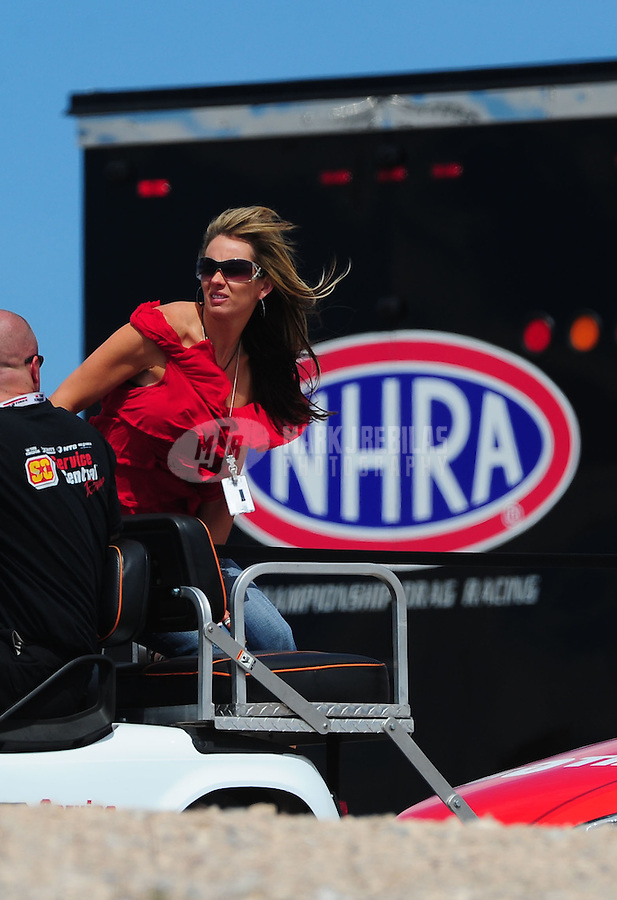 Apr. 2, 2011; Las Vegas, NV, USA: Amber Gray , wife of NHRA pro stock driver Shane Gray (not pictured) during qualifying for the Summitracing.com Nationals at The Strip in Las Vegas. Mandatory Credit: Mark J. Rebilas-