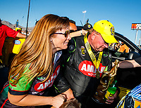 Oct 29, 2017; Las Vegas, NV, USA; NHRA top fuel driver Terry McMillen celebrates with wife Cori McMillen after winning the Toyota National at The Strip at Las Vegas Motor Speedway. Mandatory Credit: Mark J. Rebilas-USA TODAY Sports