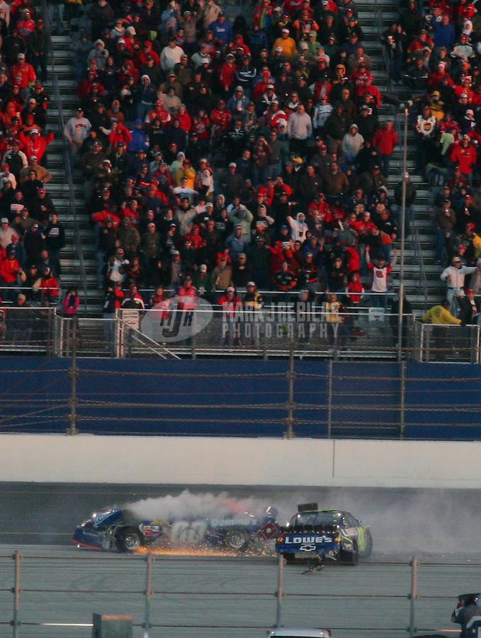 Feb 18, 2007; Daytona, FL, USA; Nascar Nextel Cup Series driver Jimmie Johnson and David Reutimann (00) crash during the Daytona 500 at Daytona International Speedway. Mandatory Credit: Mark J. Rebilas
