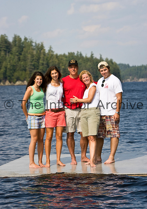 The Routh family on a jetty on the lake next to their holiday home in the Adirondack mountains