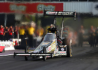 Apr 25, 2014; Baytown, TX, USA; NHRA top fuel dragster driver Brittany Force during qualifying for the Spring Nationals at Royal Purple Raceway. Mandatory Credit: Mark J. Rebilas-