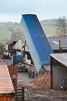 Delivering dairy cattle feed to a Cumbrian farm by lorry.