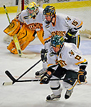 10 January 2009: University of Vermont Catamount defenseman Kevan Miller (15), a Sophomore from Los Angeles, CA, defends a face-off against the Boston College Eagles during the second game of a weekend series at Gutterson Fieldhouse in Burlington, Vermont. The Catamounts rallied from an early 2-0 deficit to defeat the visiting Eagles 4-2. Mandatory Photo Credit: Ed Wolfstein Photo