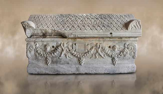 Roman relief sculpted garland sarcophagus with pitched tile sculpted roof, 3rd century AD. Adana Archaeology Museum, Turkey