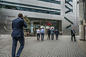 Bankers return to work at UBS after lunch break.  Broadgate Circus, part of the privately owned and managed public realm around Liverpool Street station, London.