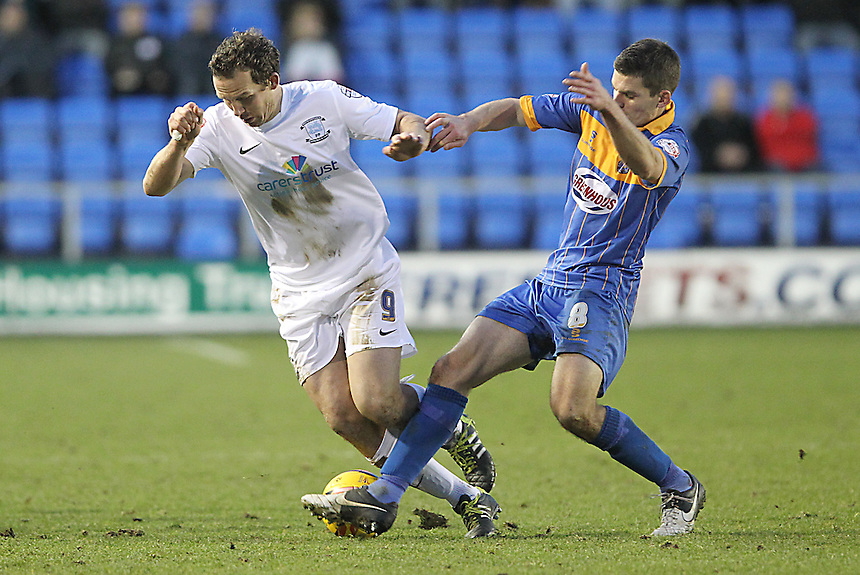Preston North End's Kevin Davies battles with  Shrewsbury Town's Dave McAllister<br />