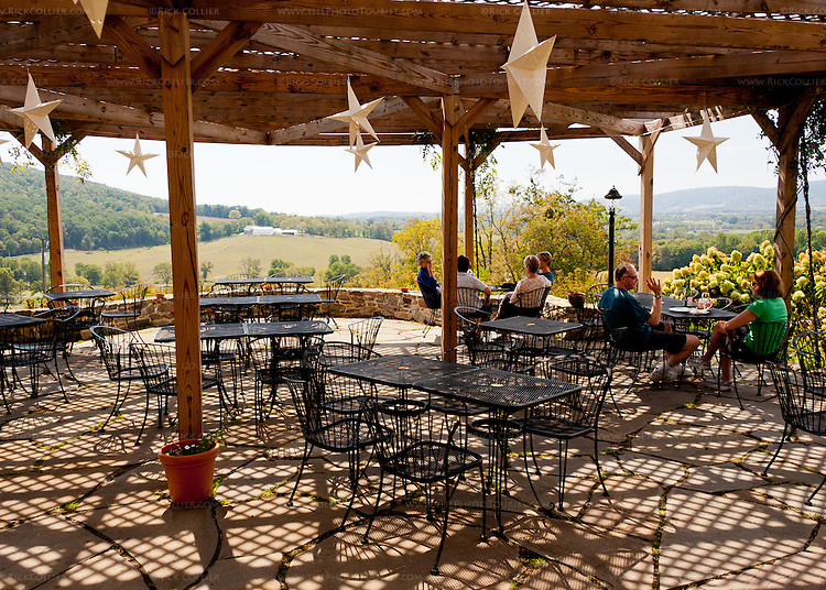 The patio at the front of Hillsborough Vineyards is shaded by lattice and offers spectacular views of the vineyards and valley beyond.