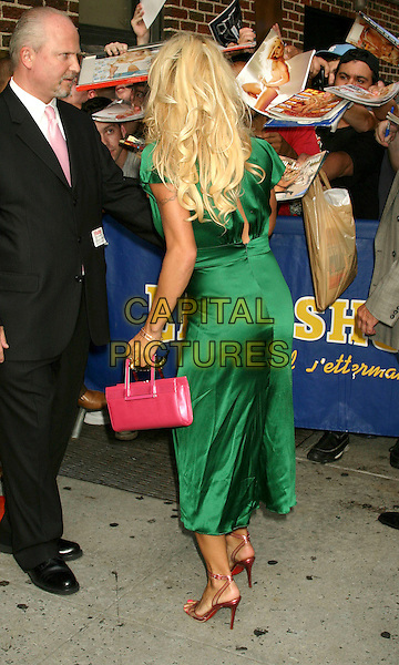 PAMELA ANDERSON.At The David Letterman Show in New York City..August 2, 2004 .full length,  green silk, satin dress, pink, fans, pink, red, bag, back, behind, rear, singing autographs.www.capitalpictures.com.sales@capitalpictures.com.©Capital Pictures .