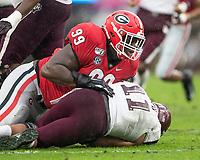 ATHENS, GA - NOVEMBER 23: Jordan Davis #99 of the Georgia Bulldogs tackles Kellen Mond #11 of the Texas A