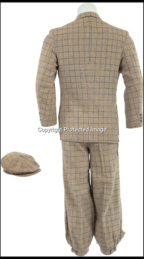 BNPS.co.uk (01202 558833)<br /> Picture: HeritageAuctions/BNPS<br /> <br /> ****Please use full byline****<br /> <br /> The beige and navy outfit which is expected to fetch £4,000.<br /> <br /> The water-stained grey woolen suit worn by Hollywood superstar Gene Kelly as he belted out the title number from hit musical Singin' in the Rain is for sale for £100,000.<br /> <br /> Kelly donned the two piece suit for the iconic centrepiece of the 1952 comedy in which he famously splashed through puddles twirling an umbrella during a downpour.<br /> <br /> Also for sale is Kelly's beige and navy outfit from the scene where Lockwood meets Cosmo Brown, played by co-star Donald O'Connor, on the set of a movie which is expected to fetch £4,000 at the Heritage Auctions sale on December 6.