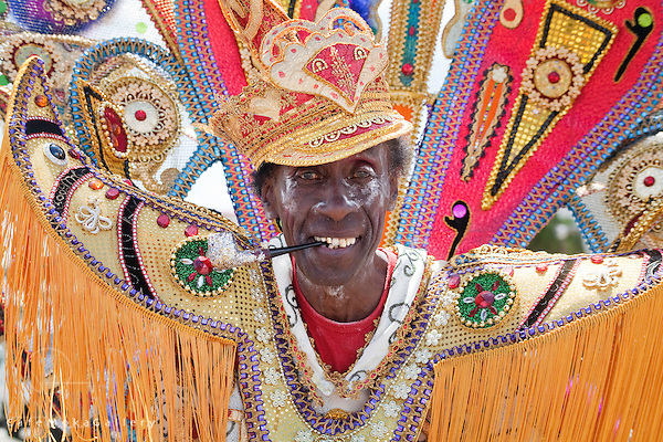 Trinidad Carnival, traditional mas, Fancy Sailor face with pipe and large epaulettes