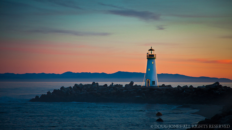 Simple lights annually decorate the Walton Light at the entrance to Santa Cruz Harbor.