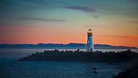 Simple lights annually decorate the Walton Light at the entrance to Santa Cruz Harbor.