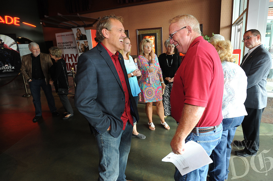 NWA Democrat-Gazette/ANDY SHUPE<br /> Marty Burlsworth (left) greets longtime friend Ron Hill of Alma Tuesday, Aug. 23, 2016, during a red carpet event ahead of the premiere of the movie &quot;Greater&quot; at the Malco Razorback Cinema 16 in Fayetteville. The movie, which opens Friday, tells the story of Burlsworth's brother, Brandon Burlsworth of Harrison, who went from walk-on to All-American for the Razorback football team. Visit nwadg.com/photos to see more photographs from the event.