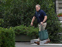 Outgoing White House Press Secretary Sean Spicer walks into the West Wing of the White House in Washington, DC, July 29, 2017. Photo Credit: Chris Kleponis/CNP/AdMedia
