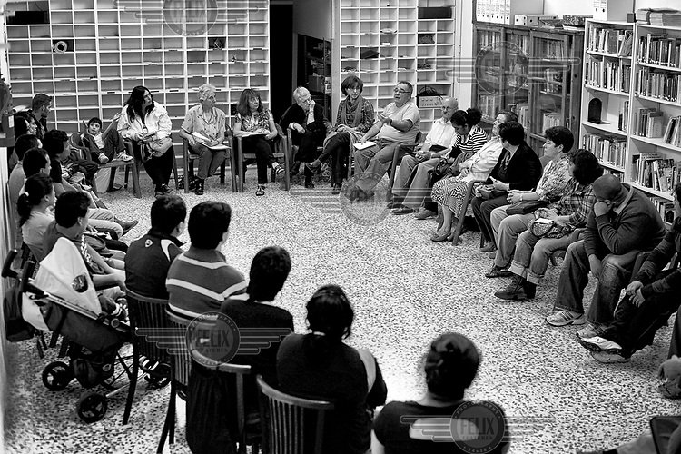 A meeting of people who have been affected by bank reposessions. In the first six months of 2012 there were 18,424 evictions in Spain.