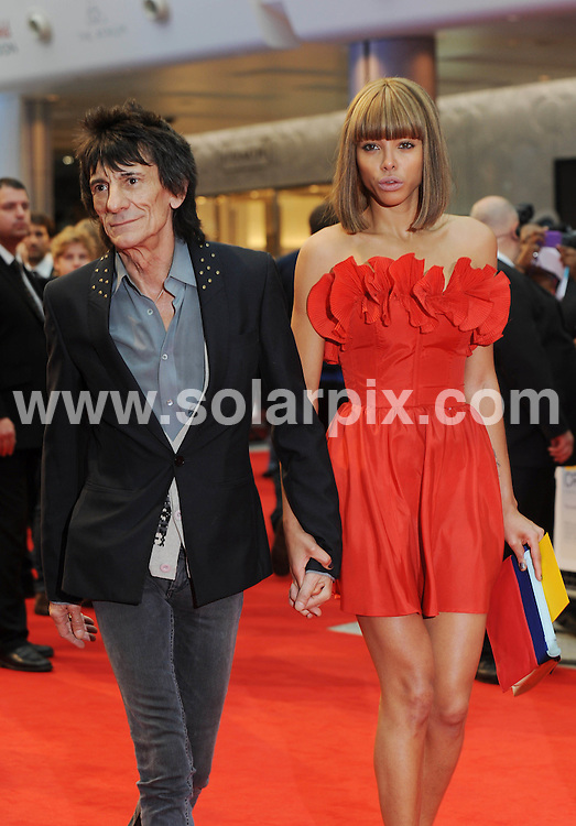 **ALL ROUND PICTURES FROM SOLARPIX.COM**                                             **WORLDWIDE SYNDICATION RIGHTS**                                                                                  Caption:The UK Premiere of Larry Crowne at Vue Westfield on June 6, 2011 in London, England.This Pic:Ronnie Wood & Girlfriend Ana Araujo                                                                           JOB REF:13513       LNJ       DATE: 06.06.2011                                                           **MUST CREDIT SOLARPIX.COM OR DOUBLE FEE WILL BE CHARGED**                                                                      **MUST AGREE FEE BEFORE ONLINE USAGE**                               **CALL US ON: +34 952 811 768 or LOW RATE FROM UK 0844 617 7637**