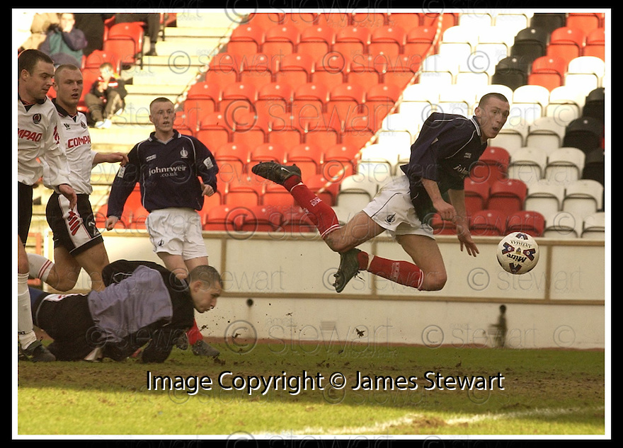 02/03/2002                 Copyright Pic : James Stewart .Ref :     .File Name : stewart-clyde v falkirk 08.LEE MILLER WATCHES AFTER HE CHIPS THE BALL OVER CLYDE KEEPER BRYN HALLIWELL TO SCORE FALKIRK'S THIRD GOAL....James Stewart Photo Agency, Stewart House, Stewart Road, Falkirk. FK2 7AS      Vat Reg No. 607 6932 25.Office     : +44 (0)1324 630007     .Mobile  : + 44 (0)7721 416997.Fax         :  +44 (0)1324 630007.E-mail  :  jim@jspa.co.uk.If you require further information then contact Jim Stewart on any of the numbers above.........