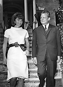 "Former first lady Jacqueline Bouvier Kennedy, left, walks West Berlin Mayor Wily Brandt, right, to his waiting car in front of her Georgetown home in Washington, DC on May 19, 1964.  Mayor Brandt took time out from his schedule to pay a courtesy call on Mrs. Kennedy.<br /> Credit: Benjamin E. ""Gene"" Forte / CNP"