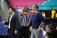 GREENSBORO, NC - MARCH 04: Official Eric Brewton signals a fouls during a game between Pitt and Notre Dame at Greensboro Coliseum on March 04, 2020 in Greensboro, North Carolina.