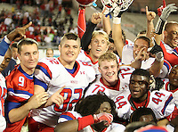 Manatee Hurricanes players, including Michael Galati #82, Kyle Mauk #72, Kelvin Carter #44, celebrate after the Florida High School Athletic Association 7A Championship Game at Florida's Citrus Bowl on December 16, 2011 in Orlando, Florida.  Manatee defeated First Coast 40-0.  (Mike Janes/Four Seam Images)