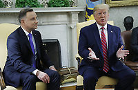 US President Donald J. Trump (R) and Polish President Andrzej Duda (L) during a meeting in the Oval Office of the White House in Washington, DC, USA, 12 June 2019. Later in the day President Trump and President Duda will participate in a signing ceremony to increase military to military cooperation including the purchase of F-35 fighter jets and an increased US troop presence in Poland. <br /> Credit: Shawn Thew/CNP/AdMedia