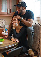 Olympic Gold champion wrestler Jordan Burroughs (cq) shares a moment with his wife Lauren Mariacher during a breakfast with friends and wrestlers at their home in Lincoln, Nebraska, Saturday, February 13, 2015. Burroughs still trains at the university where he wrestled as a student.<br /> <br /> Photo by Matt Nager
