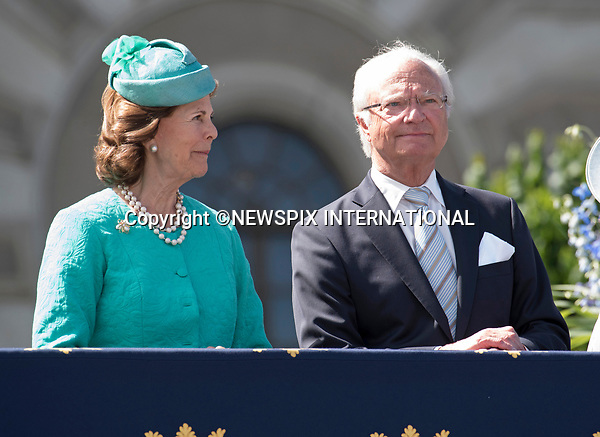 14.07.2017; Stockholm Sweden: KING CARL GUSTAF AND  QUEEN SILVIA<br /> observe the carriage procession around the city of Stockholm on the occasion of Crown Princess Victoria&rsquo;s 40th Birthday, from the balocny of the royl Palace.<br /> King Carl Gustaf, Queen Silvia, Princess Madeleine, Christopher, Prince Carl Philip and Princess Sofia cheered the Crown Princess as the carriage passed the Royal Palace balcony.<br /> Mandatory Photo Credit: &copy;Francis Dias/NEWSPIX INTERNATIONAL<br /> <br /> IMMEDIATE CONFIRMATION OF USAGE REQUIRED:<br /> Newspix International, 31 Chinnery Hill, Bishop's Stortford, ENGLAND CM23 3PS<br /> Tel:+441279 324672  ; Fax: +441279656877<br /> Mobile:  07775681153<br /> e-mail: info@newspixinternational.co.uk<br /> Usage Implies Acceptance of Our Terms &amp; Conditions<br /> Please refer to usage terms. All Fees Payable To Newspix International