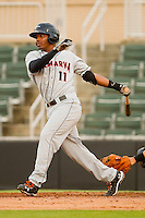 Mychal Givens #11 of the Delmarva Shorebirds follows through on his swing against the Kannapolis Intimidators at Fieldcrest Cannon Stadium on May 23, 2011 in Kannapolis, North Carolina.   Photo by Brian Westerholt / Four Seam Images