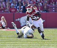 NWA Media/Michael Woods --10/25/2014-- w @NWAMICHAELW...University of Arkansas running back Alex Collins shakes a UAB defender as he runs for a gain in the 2nd quarter of Saturday's game at Razorback Stadium in Fayetteville.