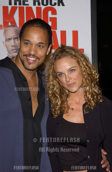 Actress NIKTA AGER & actor KEITH HAMILTON COBB at the world premiere, in Hollywood, of Walking Tall..March 29, 2004