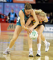 11.07.2010 Magic's Laura Langman and Thunderbirds Sharni Layton in action during the ANZ Champs Final netball match between the Magic and Tunderbirds played at the Adelaide Entertainment Centre in Adelaide. ©MBPHOTO/Michael Bradley