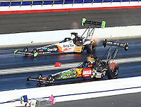 Feb 12, 2017; Pomona, CA, USA; NHRA top fuel driver Terry McMillen (near) races alongside Clay Millican during the Winternationals at Auto Club Raceway at Pomona. Mandatory Credit: Mark J. Rebilas-USA TODAY Sports